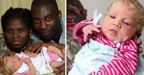 Parents noirs avec bébé blanc